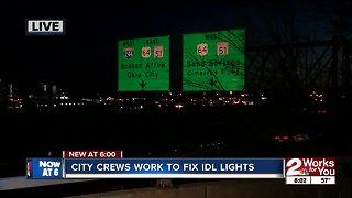 Crews work on street lights along IDL in downtown Tulsa
