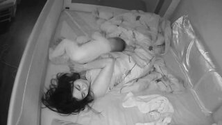Monitor captures sleepless baby's efforts to get tired mom to play