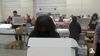 United Way volunteers pack back-to-school boxes to help kids start off on the right foot