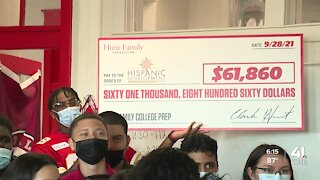 Chiefs Community Caring Team presents check to the Greater Kansas City Hispanic Development Fund