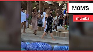 Beyonce's mother strutted her stuff at Magic Johnson's star-studded 60th birthday bash in St Tropez.