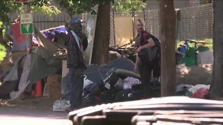 Homeless camp cleanup underway near Morey Middle School