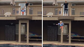 Fearless toddler jumps from impressive height into pool