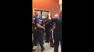 Hilarious video of firefighters rescuing police from elevator