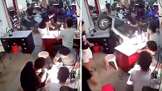 Out Of Control Scooter Crashes Into Phone Repair Shop And Narrowly Misses Customer's Head