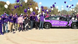 Dozens gather to recognize victims during Silent Witness Walk of domestic violence