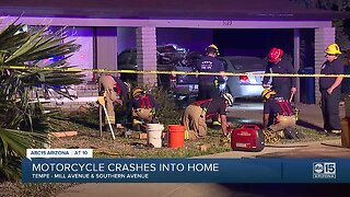 Two people critical after motorcycle crashes into a house in Tempe