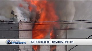 Firefighters battle large fire as building collapses in downtown Grafton