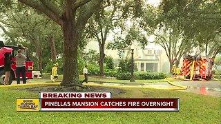 Crews battle large house fire in Belleair