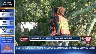 Polk County inmates helping clean tornado damage