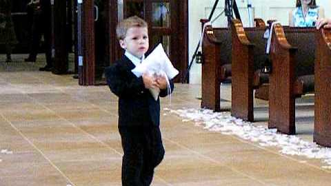 Cute Ring Bearer Takes His Precious Time And Slowly Walks Down The Aisle