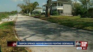 Neighbors in Tarpon Springs fight sidewalk construction