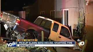 Pickup slams into house, starting fire