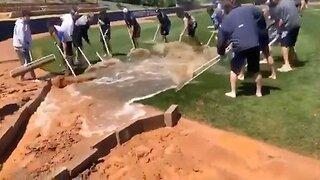 Baseball Team Clear Waterlogged Field With Ingenious Method Using Just Rakes