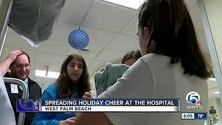 High school students spread holiday cheer at hospital in West Palm Beach