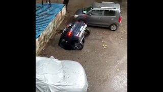 Car falls after rain