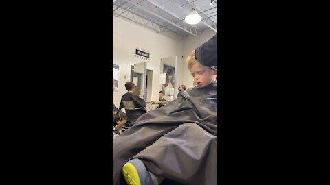 2 yr old falls asleep for his first salon haircut