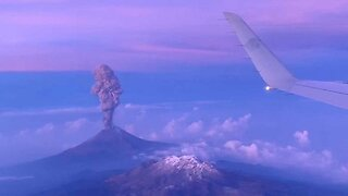 Stunning volcano explosion filmed from plane window