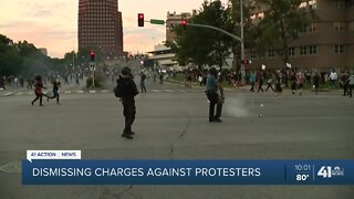 Dismissing charges against protesters