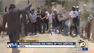 Residents demand the firing of two deputies