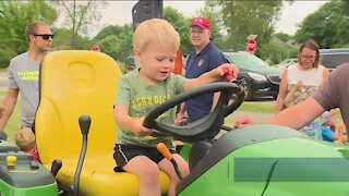 People learn about equipment used by local businesses, government at Touch-A-Truck event