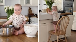 Hardworking baby helps mommy with all the housework