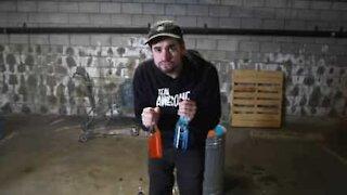 Artist plays song using bottles