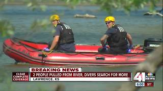 2 people pulled from river, divers search for other possible victims
