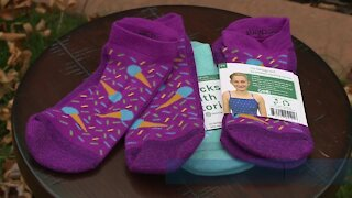 Local girl who fought cancer gives back with socks