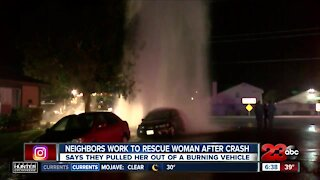 Neighbors work to rescue woman from burning vehicle