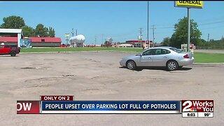 Keys residents upset over parking lot full of potholes