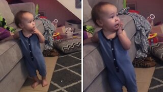 Baby boy has the most adorable jump scare from movie scene