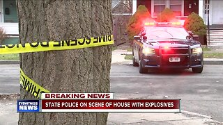 Police investigate home with explosives