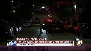 Police swarm neighborhood after homicide