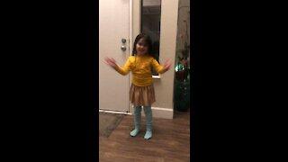 Doing her dance moves