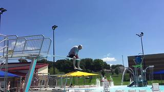 Senior Man Dives Into A Swimming Pool