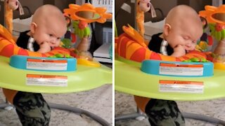 Tired baby literally falls asleep while bouncing in jumper