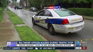 Baltimore officer injured after being dragged by car