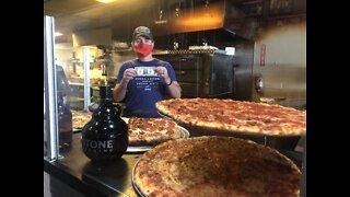 Pacific Beach pizza restaurant donates thousands of dollar bills that decorate walls