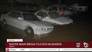 Broken water main floods Santee street, auto repair business