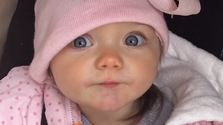 Beautiful baby girl gives kisses for mommy