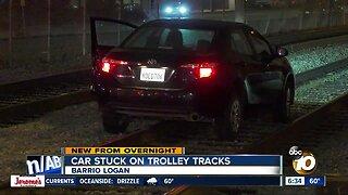 Car becomes stuck on trolley tracks in Barrio Logan