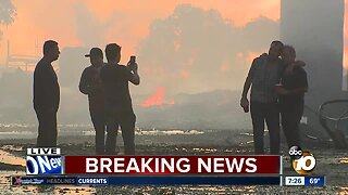 Evacuations lifted after fire tears through Otay Mesa