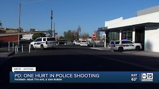 PD: Man holding baby seriously injured in police shooting near 7th Avenue and Van Buren Street