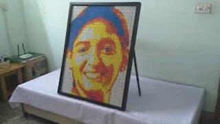 Artist creates portrait using 720 Rubik's Cubes