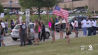 Health care workers protest vaccine mandate at local hospitals