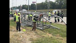 Driver killed after crash topples sign