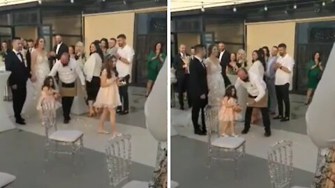Shy flower girl gets extra help throwing rose petals