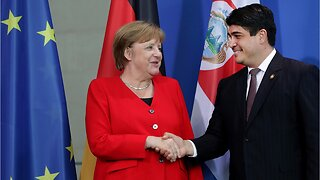 Angela Merkel warns 'dark forces' on the rise in Germany