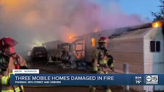 Three mobile homes catch fire Saturday near 16th St. and Osborn Rd.